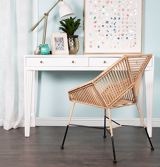 Like many of its other furnishings, David Francis's Brier side chair is made of renewable rattan.
